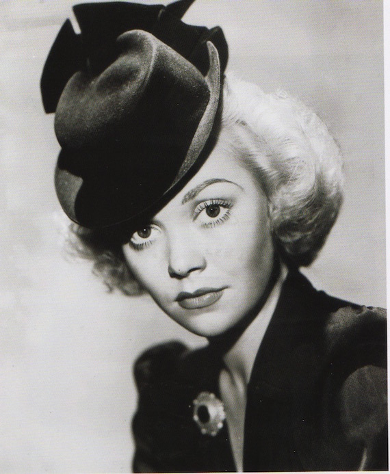 An actress showing a fashionable hat.