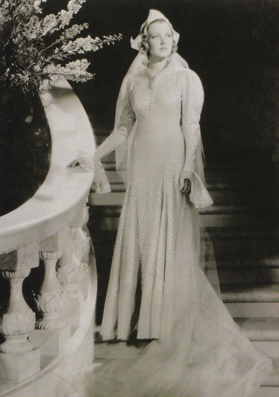 1930s Wedding dress with lace overlay.